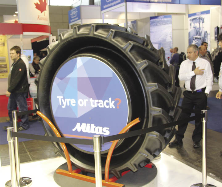 Tractor tire on display at trade show.