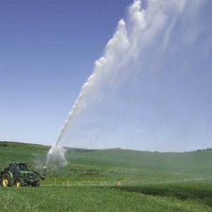 Water spraying across a farmer's field.