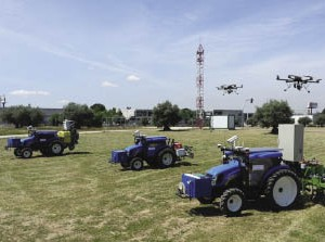 Aerial drones and driverless tractors team up to search for and destroy weeds in farm fields in the RHEA robotics prototype system.