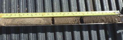 The zero- to four-inch level is the new topsoil hauled in from the lower land. The four- to seven-inch level is what passed for topsoil for many years. It's really upper subsoil.