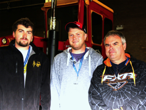 Jerrod (left) Jeff (centre) and Ian (right) Wilson plan to continue showing their tractor at future farm shows.