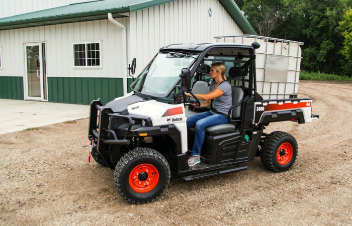 woman driving a Bobcat utility vehicle