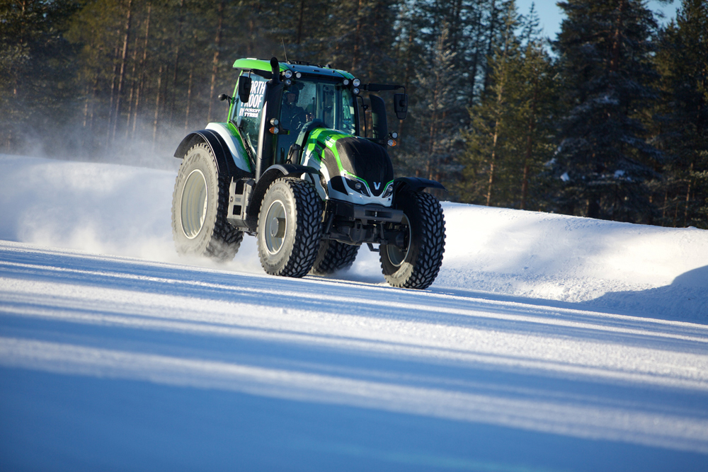 tractor speeding across snow
