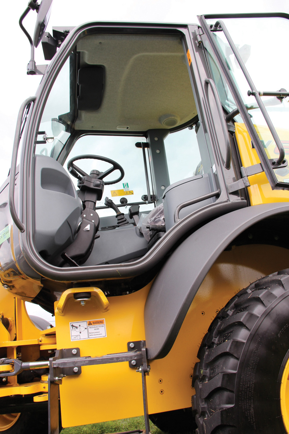 Even though the C Series loaders were re-engineered to be more compact, they still offer a relatively spacious cab.