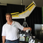 Markus Weber, president of AgEagle Canada stands with the two types of UAVs his company retails.