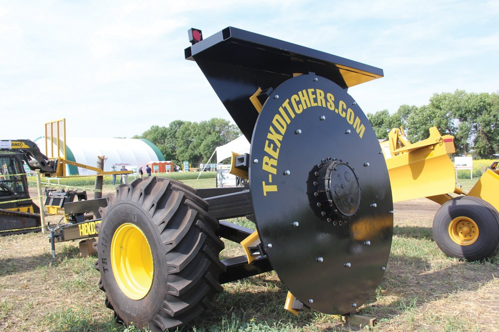 The T-Rex rotary ditcher uses an eight-foot rotary cutter to quickly create drainage runs.