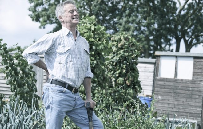 Man Suffering From Back Pain Whilst Gardening