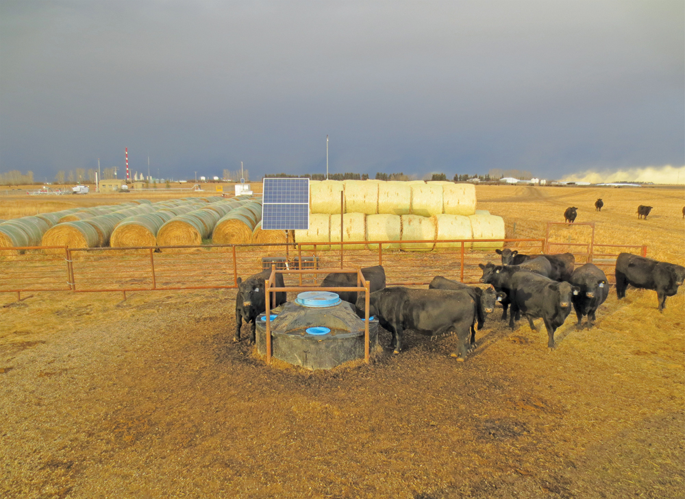 This is a completed year-round CAP Solar system over a cased well. Systems can be designed to supply anything from a few horses to a 500-head cow herd.