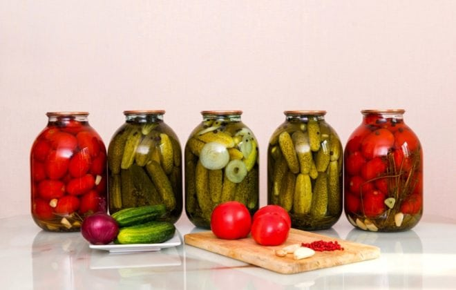 vegetables, fresh, raw, tomatoes, garlic, red, pepper, cucumbers on the table on a plate and cutting Board, jars of pickles, jars of pickles and tomatoes on a table, food