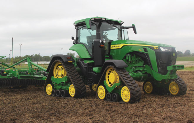 John Deere debuts the industry's first line of rigid-frame four-track tractors.
