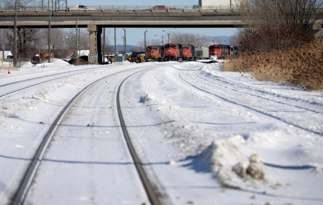 CN locomotives are seen on track near a railway blockade at St-Lambert, Que. on Feb. 20, 2020. (Photo: Reuters/Christinne Muschi)