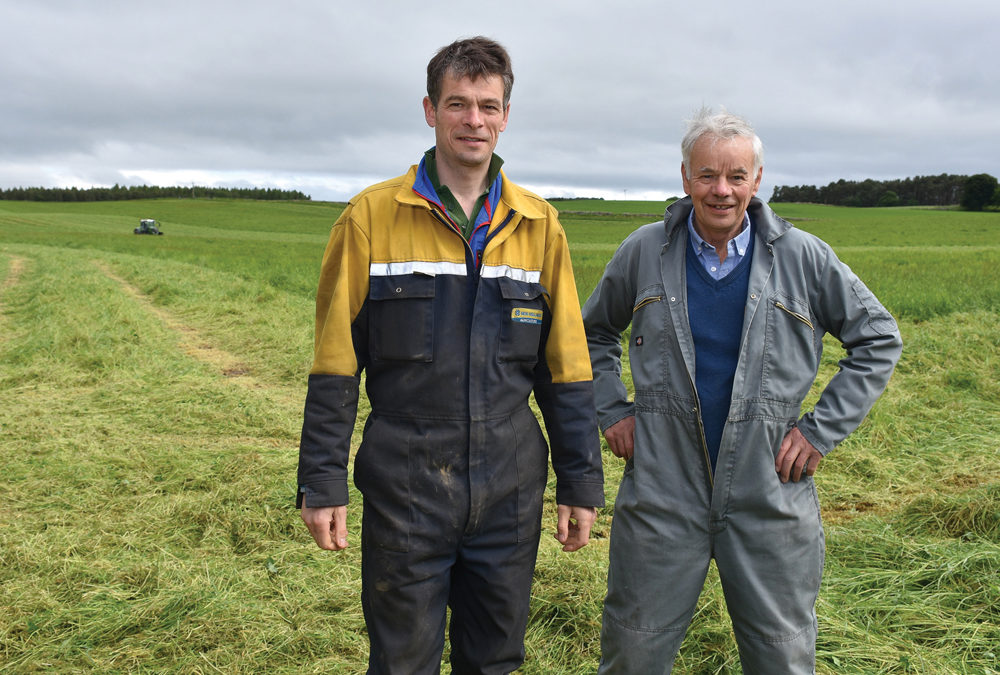 Mike Martin, right and son Ali are part of the family operated mixed farming operation on Scotland's  Black Isle peninsula, where they produce cereal crops, potatoes and beef.