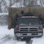 The four-wheel-drive post pounder truck served double duty in getting hay out to cattle after the snowstorm.