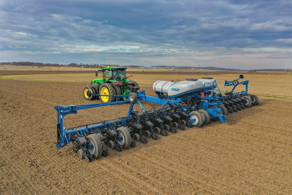 Kinze's 24-row 4905 True Speed planter is shown above. The True Speed system allows corn and soybean farmers to plant at speeds up to 12 miles per hour without compromising singulation or seed spacing.