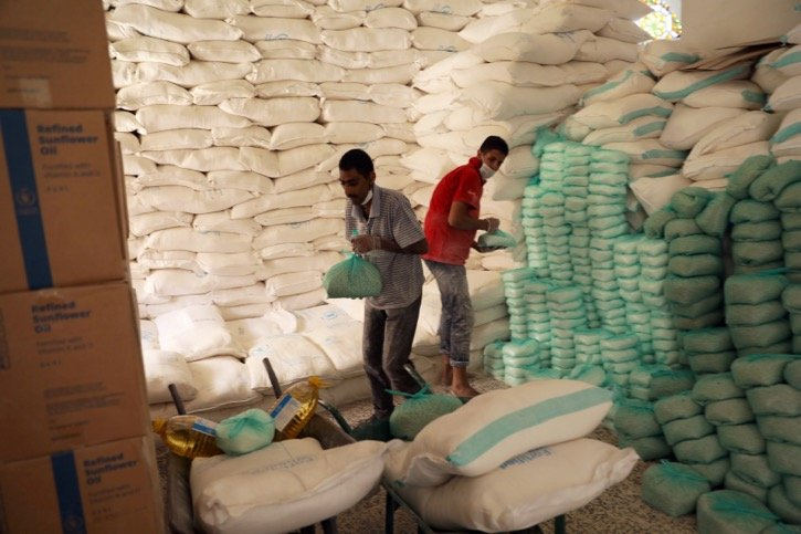 Workers prepare foodstuffs at a food distribution centre supported by the World Food Program at Sanaa, Yemen's capital, on June 3, 2020. File photo: Reuters/Khaled Abdullah