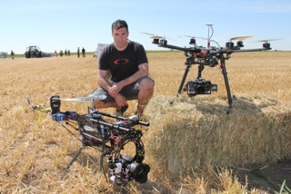 Layne Van Rhijn with two specially designed helicopters for aerial photography.