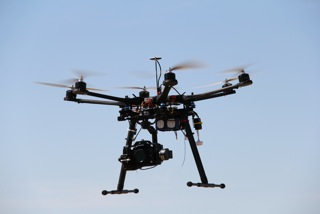 Camera is mounted below the body of this multi-rotor copter.